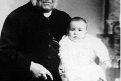 Rev. Cary and child. Not sure if it's son or daughter?
