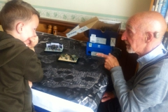 Paul Bennett explains scale model progress to Brixham primary schoolpupil.