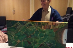Project artist Dave Brumwell with his Victorian  'Cowtown Parish' map painting.