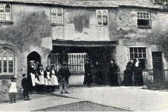 Church gate medieval houses circa 1890.