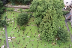 View from top of church tower down to grave yard.