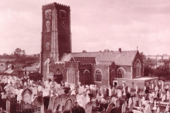 Toned photograph of church and yard circa 1930.