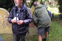 Ecologist Nigel Wood recording lichen growth on grave stones.